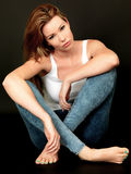 Sexy Young Woman Sitting on Floor Stock Images