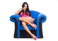 Sexy young woman sitting in provocative pose Royalty Free Stock Photography