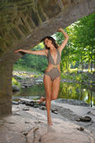 young woman with slim perfect figure posing in design swimsuit Stock Image