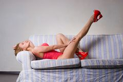 Sexy young woman on the sofa Royalty Free Stock Image