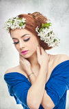 Sexy young woman with spring white flowers Royalty Free Stock Photos
