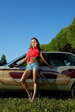 Sexy young woman stay near retro graffiti car Royalty Free Stock Photos