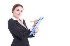 Sexy and young woman supervisor writing on clipboard Stock Images