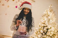Attractive young woman celebrating New Year at home stock photo