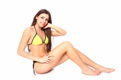 Sexy young woman in a swimsuit posing on a white background Royalty Free Stock Photo