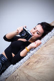 Sexy young woman taking pictures Stock Image