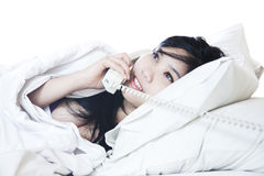 Sexy young woman talking on the phone Royalty Free Stock Photos