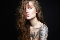 Sexy Young Woman with Tattoo royalty free stock image
