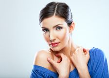 Sexy young woman touching neck. Beauty portrait with clear skin. Naked shoulder, sensual posing Stock Photography