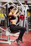 Sexy young woman training at the gym Stock Photo
