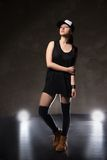 Sexy young woman in a trendy clothes over black Stock Photo
