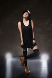 Sexy young woman in a trendy clothes over black Royalty Free Stock Photo