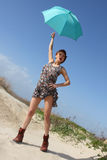 Sexy young woman with an umbrella Royalty Free Stock Images