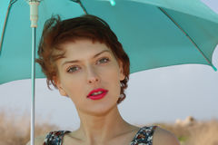 young woman with an umbrella Royalty Free Stock Images