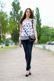 Sexy young woman walking Stock Photo
