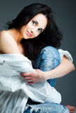 Sexy young woman on wearing blue jeans Royalty Free Stock Photo