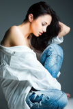 young woman on wearing blue jeans Royalty Free Stock Photos