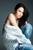 Sexy young woman on wearing blue jeans Stock Photography