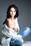 Sexy young woman on wearing blue jeans Stock Photos