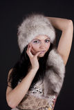 Sexy young woman wearing fur-cap. Stock Photography