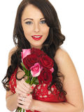 Sexy Young Woman Wearing Red Lingerie and Holding Red Roses. Sexy Young Woman Wearing Red Lingerie and Holding Red Valentines Roses Royalty Free Stock Photo
