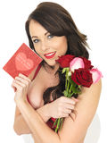 Sexy Young Woman Wearing Red Lingerie and Holding Red Roses Stock Photography