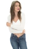 Sexy Young Woman Wearing a White Vest Top and Blue Jeans Royalty Free Stock Photography