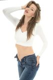 Sexy Young Woman Wearing a White Vest Top and Blue Jeans Royalty Free Stock Images