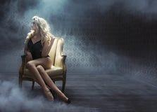 Sexy young woman among white smoke Stock Photos