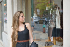 Sexy young woman window shopping Royalty Free Stock Images