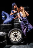 Sexy young women sitting on a tires Royalty Free Stock Images