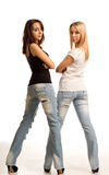 Sexy young women in tight fitting jeans Stock Images