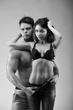 Sexynaked couple of muscular boy in underwear and girl undressing. Sexy young naked couple of muscular boy in underwear and girl undressing studio Royalty Free Stock Photography