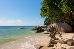 Seychelles Beach 1. Typical granite rocks on a quiet and romantic part of Beau Vallon beach on Mahe island, Seychelles Royalty Free Stock Photo