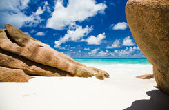 Seychelles beach with granite rocks, blue sky with clouds Stock Image