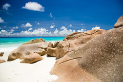 Seychelles beach with granite rocks, sandy beach, blue water Royalty Free Stock Images