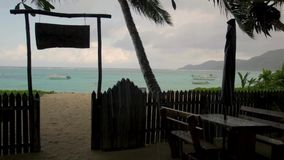 Seychelles, a cafe on the beach in the rain. 2013. Seychelles, a cafe on beach in the rain. 2013 stock video