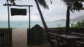 Seychelles, a cafe on the beach in the rain. 2013. Seychelles, a cafe on beach in the rain. 2013 stock footage