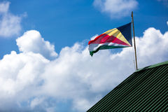 The Seychelles flag. On the roof Royalty Free Stock Photos