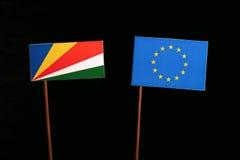 Seychelles flag with European Union EU flag  on black Royalty Free Stock Image