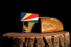 Seychelles flag on a stump with bread Royalty Free Stock Photography