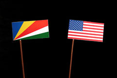 Seychelles flag with USA flag  on black Royalty Free Stock Photography