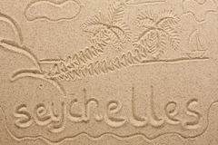 Seychelles handwritten from  sand Stock Images