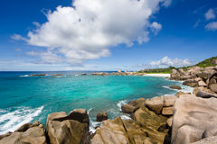Seychelles island landscape, rocks, turquise sea, clouds, blue sky. Stock Photo