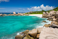 Seychelles island landscape, rocks, turquise sea, clouds, blue sky. Stock Photography