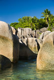 Seychelles island, typical granite rocks, plants and sea shore Royalty Free Stock Images