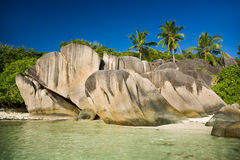 Seychelles, La Digue island beach, granite rocks, palm trees Royalty Free Stock Photography