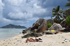 Seychelles. La Digue Island. Stunningly beautiful beach. Perfect place to stay. The picturesque beach Anse Source d`Argent surrounded by huge black quaint stock photos
