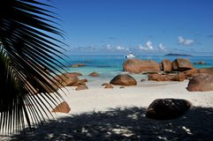 Seychelles palm, rocks, boat and see Stock Image