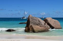 Seychelles. Praslin Island. The picturesque beach of Anse Lazio with views of the yachts royalty free stock images